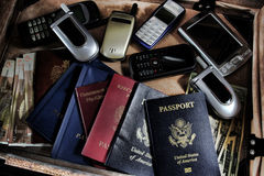 Briefcase Kit with Fake Passports and Money. Assorted nationality fake passports in international criminal counterintelligence spy briefcase emergency mission stock image