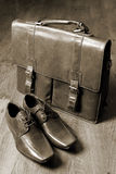 Briefcase and leather shoes Stock Photo