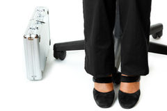 Briefcase at legs of business woman Royalty Free Stock Image