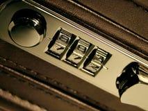 Briefcase Lock. A macro shot of a briefcase combination lock Royalty Free Stock Photo
