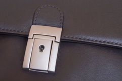 Briefcase lock. With keyhole close-up stock photos