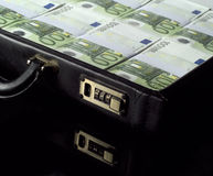 Briefcase with money. On black background royalty free stock photos