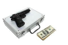 Briefcase,money and gun Royalty Free Stock Photography