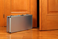 Briefcase near the door Stock Images