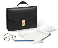 A briefcase and notebook and some office supplies. Royalty Free Stock Photos
