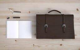 Briefcase and notebook Stock Photos