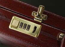 Briefcase with opened lock. Burgundy leather executive briefcase with opened lock Stock Photos