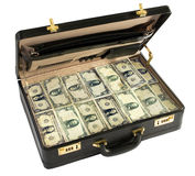 Briefcase packed full of dollar bills Royalty Free Stock Photography