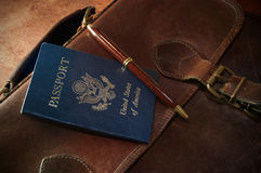 Briefcase with Passport and Pen Stock Photo