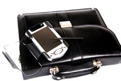 Briefcase and pocket pc. Royalty Free Stock Image