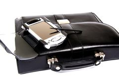 Briefcase and pocket pc. Stock Photo