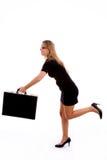 briefcase running side view woman young Στοκ φωτογραφία με δικαίωμα ελεύθερης χρήσης