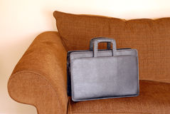 Briefcase on a sofa Stock Photos