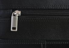Briefcase Zip Detail. Detail of zip on a leather briefcase Royalty Free Stock Image
