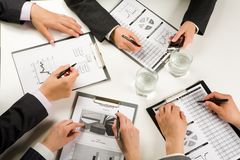 At briefing. Photo of business people hands working with documents at briefing Royalty Free Stock Images