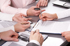 At briefing. Photo of business people hands working with documents at briefing Stock Image