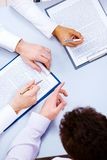 At briefing. Photo of business people hands working with documents at briefing Stock Images