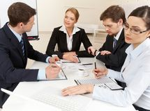Briefing. Portrait of confident business partners interacting and working at meeting stock images