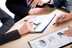 Briefing. Image of business people�s hands during teamwork stock photo