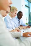 At briefing. Vertical image of business people sitting in office and planning work royalty free stock image