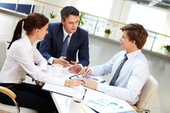 Briefing. Business leader asking his employees about results of work royalty free stock photo