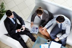 Briefing. Overview of business team discussing the results of a new strategy royalty free stock image