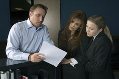 Briefing. Business team members discussing on a briefing Royalty Free Stock Photos