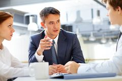 Briefing. Business leader asking his employee about results royalty free stock photography