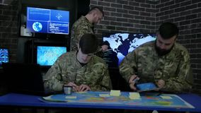 Briefing, discussing battle strategy holding digital tablet, team