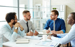 Briefing. Intercultural business team consulting at briefing Stock Image