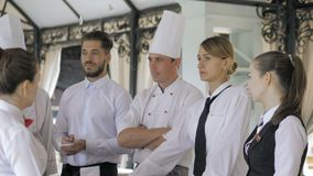 Briefing at the restaurant. Interacting to head manager in commercial kitchen.  stock video
