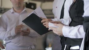 Briefing at the restaurant. Interacting to head manager in commercial kitchen.  stock video footage