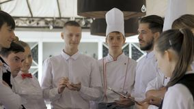Briefing at the restaurant. Interacting to head manager in commercial kitchen.  stock footage