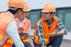 Briefing. Team of construction workers having briefing before work Stock Photos