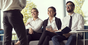 Briefing. Three young business people on a briefing in manager's office Stock Photo