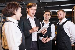Briefing of waiters stock photos
