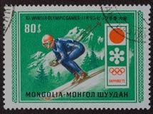 Briefmarke Mongolei-Olympische Winterspiele Stockfotos