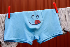 Briefs with smiley sticking out tongue Royalty Free Stock Photo