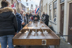 Children playing dutch shuffleboard on the street during festiva Stock Images