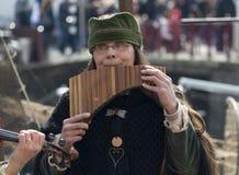 Woman playing panflute Stock Photos
