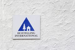 Hostelling International sign on white wall Royalty Free Stock Images