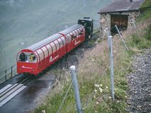 29.07.2018 brienzer rothorn - old stream train arriving on the brienzer rothorn in the swiss alp stock photos