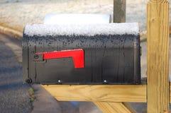 Brievenbus in sneeuw Stock Afbeelding