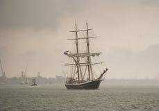 Brig in heavy rain. A brig in heavy rain sailing on the river Royalty Free Stock Photos