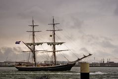 Brig on the river in heavy rain. The brig is a very old and efficient sailing rig Royalty Free Stock Photos
