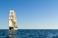 Brig sailing away. Swedish brig Tre Kronor af Stockholm underway by sail in the middle of Baltic Sea. Free horizon and a light breeze Stock Photography