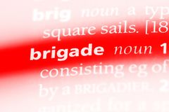 Brigade. Word in a dictionary.  concept Stock Photo