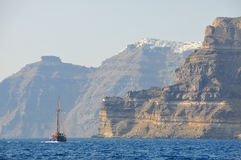 Brigantine in the Mediterranean Sea. Against the backdrop of the cliffs and Santorini Island stock photo