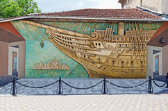 Brigantine panels in Feodosia. FEODOSIA, CRIMEA, RUSSIA - JUNE 12: Architectural landmark - bas-relief Brigantine on an old building in the center of Feodosia on stock images