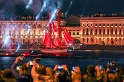 Brigantine Scarlet Sails at the Dvortsovaya Embankment. Festive night show of graduates of St. Petersburg Scarlet sails Stock Photo